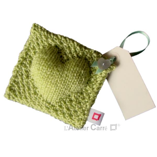 coussin de porte en tricot décoratif vert anis