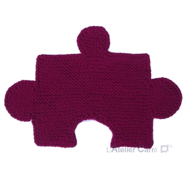 set de table design en tricot forme puzzle combinable fuchia