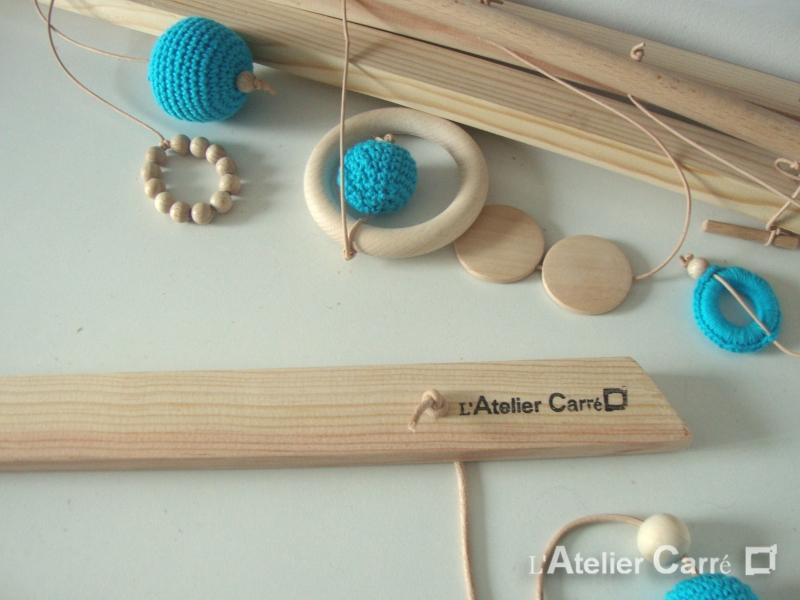 portique-d-eveil-bebe-bois-crochet-detail-marquage