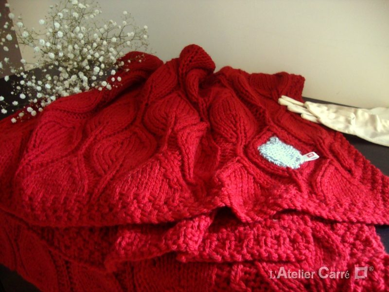 Étole ou jeté de canapé en tricot